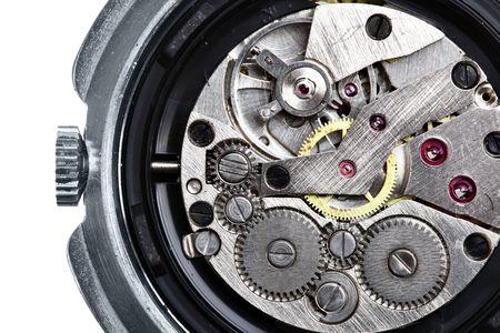 Clockwork of wristwatch isolated over white background photo