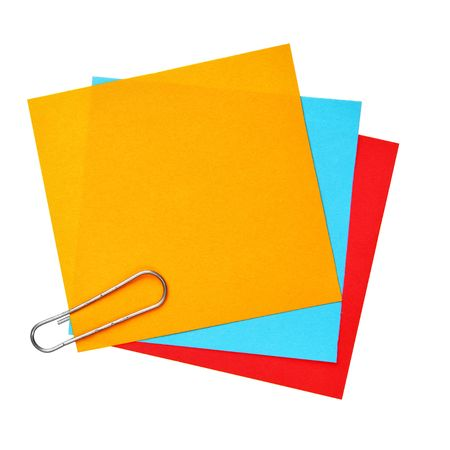 Blank colorful papers with clip isolated over white background photo