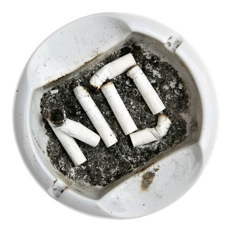 Word NO made from cigarettes stubs in the ash-tray photo