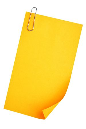 Blank paper (yellow) with clip isolated over white background photo