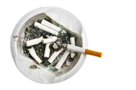 Ash-tray with cigarette stubs isolated over white background photo