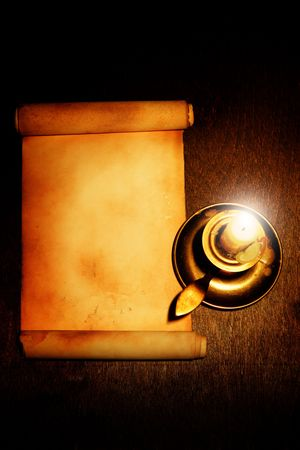 witchery: Old scroll and candle on wooden table