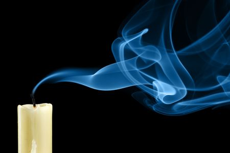 Extinguished candle with smoke close-up photo