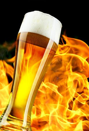 Beer glass close-up and flame in the background photo