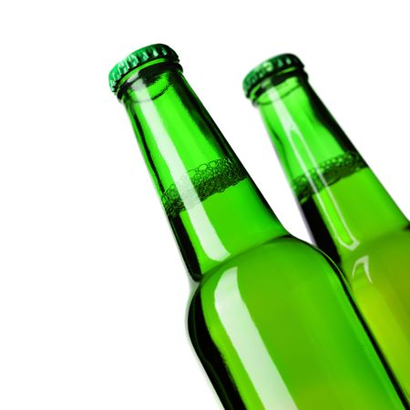 Close-up of two beer bottles isolated over white background photo