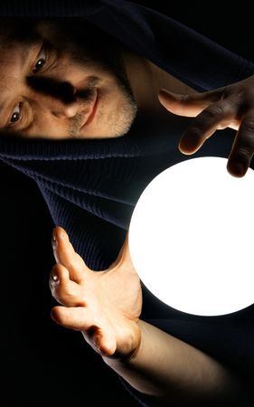 Wizard with glowing magical ball. Focus on the hands Stock Photo - 5282666