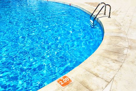 Swimming pool with stairs at hotel close up Stock Photo - 5283719