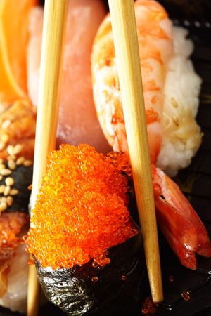 Traditional japanese sushi close-up and chopsticks photo