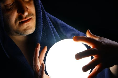 Wizard with glowing magical ball Stock Photo - 5307956