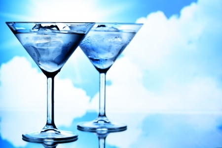 bar ware: Cocktail glass with ice and sky in the background Stock Photo