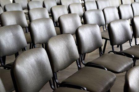 Seats in a row prepared for conference photo
