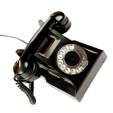 rotary dial telephone: Tel�fono Vintage aislados en el fondo blanco