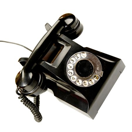 rotary dial telephone: Vintage phone isolated over the white background