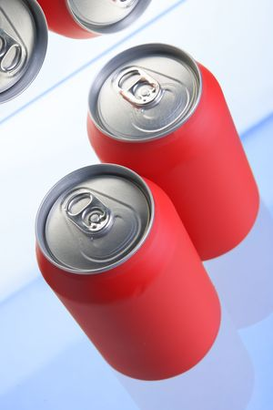 Red drink cans close up in fridge  photo
