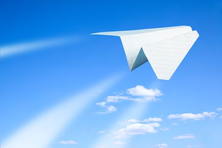 toy plane: Paper plane flying. Sky and clouds in the background