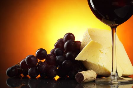 Still-life with grapes, cheese and red wine photo