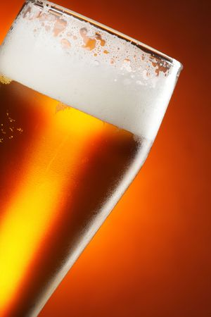 froth: Glass of beer with froth close up