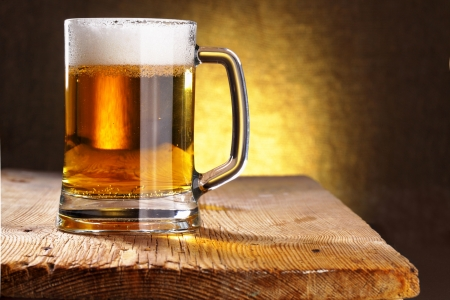 Beer mug close-up on the wood table Stock Photo - 5601497