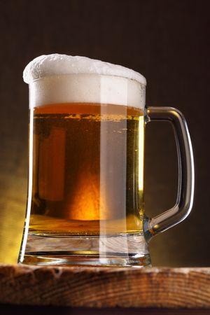 tankard: Beer mug close-up on the wood table