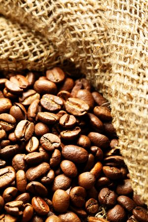Coffee beans in sack close up photo