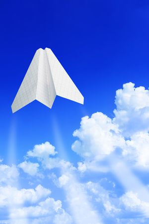 Paper plane take off. Sky and clouds in the background photo