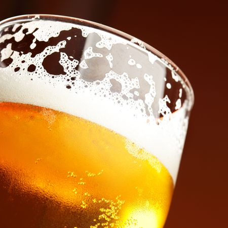 beer: Close up of beer glass with froth