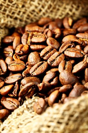 Coffee beans in a sack close up photo