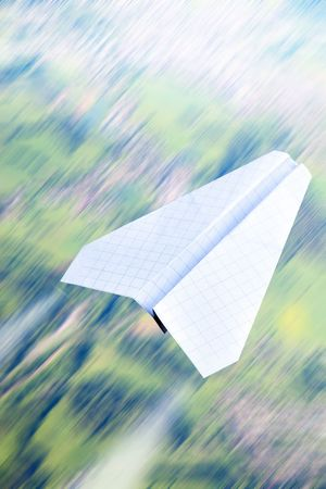 Aerial view in motion blur and paper plane  photo