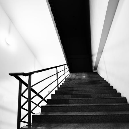 backstairs: Wide angle shot of stairs. Black and white image Stock Photo
