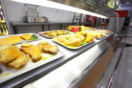 lunch tray: Hot trays with cooked food on showcase at cafeteria