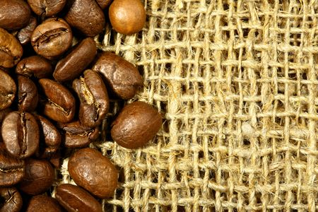 Coffee beans on sacking and space for your own text on right photo