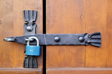 smithery: Padlock close-up on a old wooden door Stock Photo
