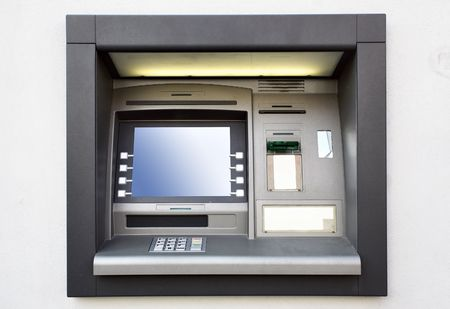 Automated teller machine close up on a wall photo