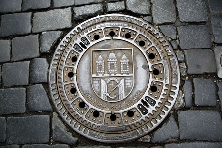 Man hole cover in Prague, Czech republic photo