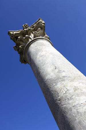 Perspective of classic column against blue sky photo
