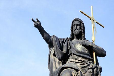 Jesus with cross at Charles bridge, Prague, Czech republic photo