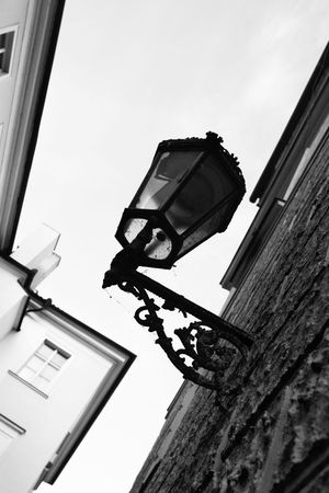 Old lantern at narrow street at Prague, Czech. Black and white image. Stock Photo - 5897012