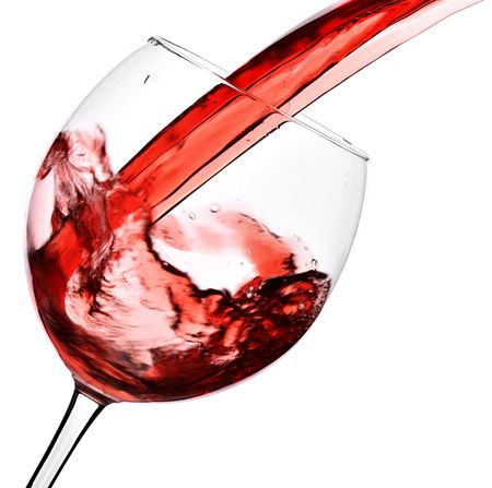 Red wine pour into glass isolated over white background Stock Photo - 5949940