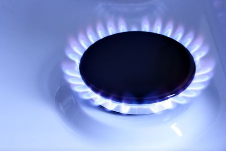 Blue gas flame on hob close up photo