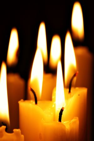 kwanzaa: Burning candles close-up over a black background