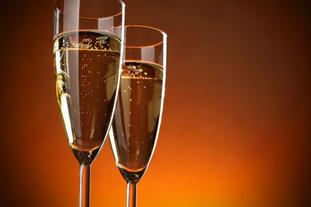 Two glasses of champagne over red background photo