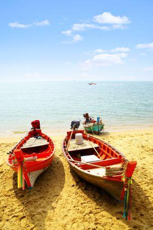 Three fshing boats close-up at sandy beach photo