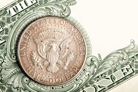 Half dollar coin close up on banknote photo
