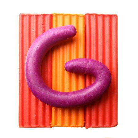 Letter G - Plasticine alphabet isolated over white background photo