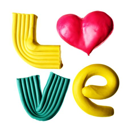 Word LOVE made from plasticine isolated over white background photo