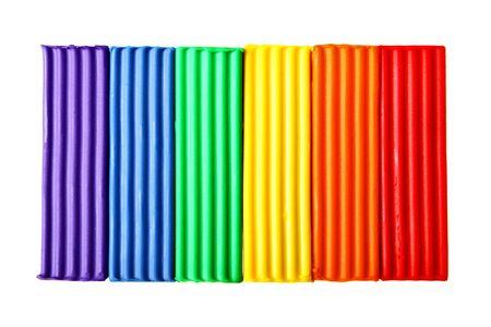 educaton: Colorful plasticine isolated over the white background