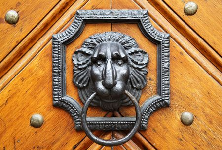 door knob: Door knocker in the form of lion head Stock Photo