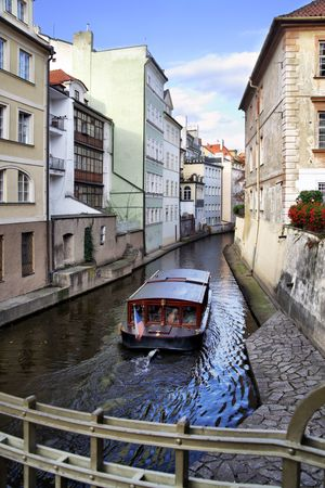 Narrow canal and boat at Prague. Czech Republic Stock Photo - 6493415
