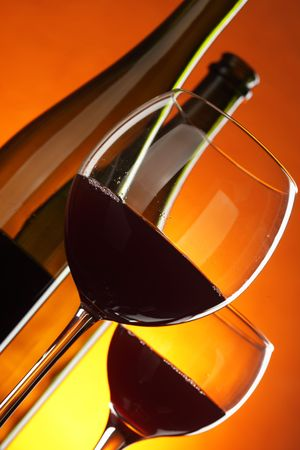 Bottles and glasses of red wine close-up Stock Photo - 6493402