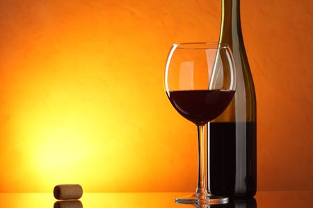 Glass and bottle of red wine on table Stock Photo - 6540665